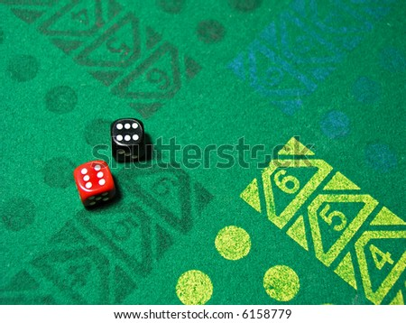 two dice with number six in green table game