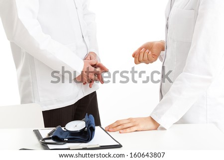 Two doctors at work at the office, isolated