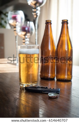 Empty Beer Bottles On Table