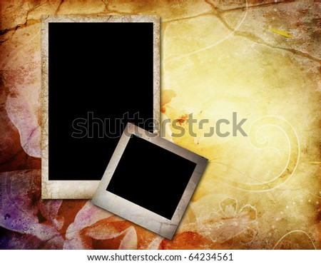 two empty photo frames on old paper background
