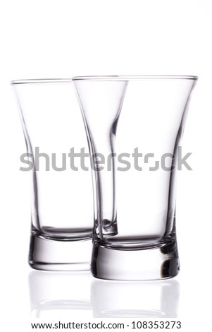 Two empty shot glasses isolated on white background