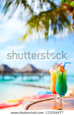Two exotic cocktails in a tropical setting