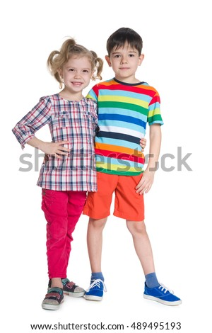 Two fashion children stand together on the white background