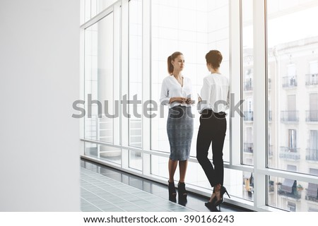 Successful Architects confident women reading information about finance stock photo