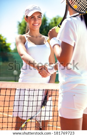 Two female tennis players shaking hands,