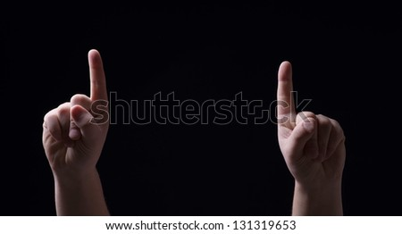 Two fingers on the black background