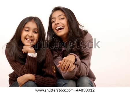 two friends sitting together enjoying watching film isolated on white background