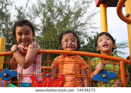 Two giris and a boy playing at the park