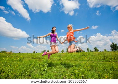 two girlfriends having fun in blue sky