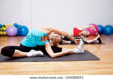 Two girls training in fitness club