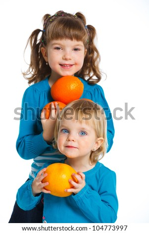 Two girls with oranges, isolated on white background