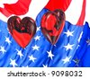 Two glass hearts floating over an American flag with reflections and refractions. Show our troops that your heart is with them. - stock photo