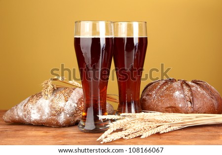 two glasses of kvass with bread on brown background close-up