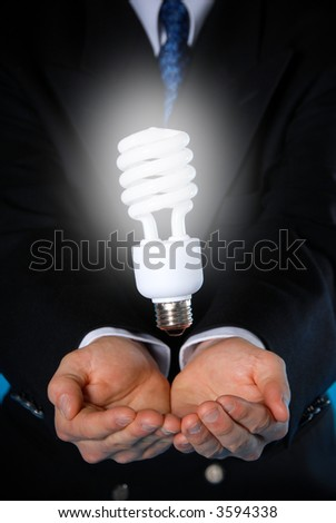 two hands with a floating light bulb