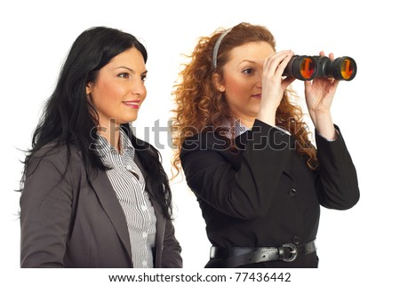 Two happy business women looking into binocular to the future isolated on white background