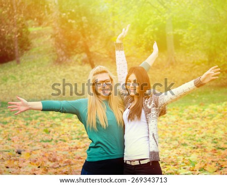 Two happy girl friends in nature