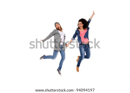 two happy girls in the air isolated on a white background