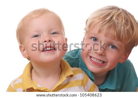 Two happy young kids on white background