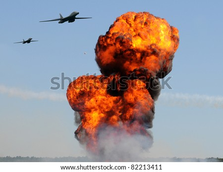 Two heavy bombers attacking ground targets with giant explosions