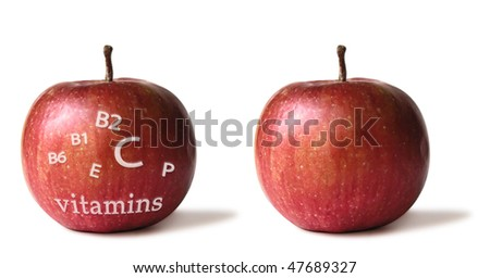 Two isolated apples with vitamins list and in white background