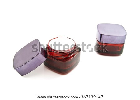two jars of cream on white background