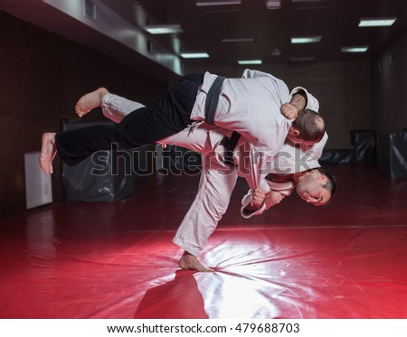 Two karate fighters showing technical skill while practicing Martial arts in a fight club