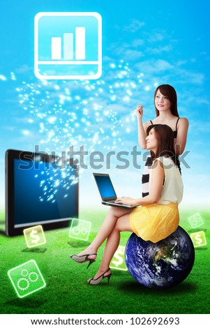 Two lady look at the Graph icon from touch pad : Elements of this image furnished by NASA