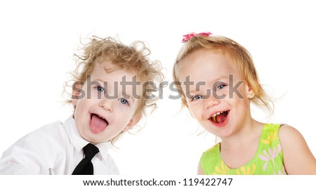 two laughing children.looking at camera. isolated on white background