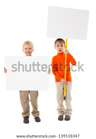 Two little boys are holding blank banners.
