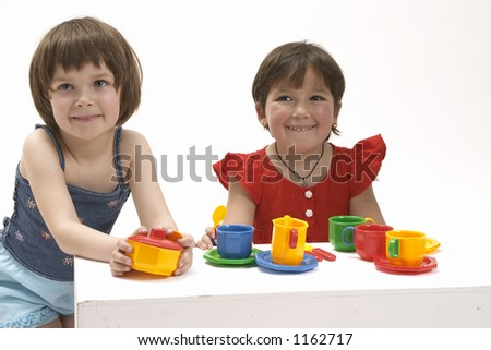 two little girls are play the game