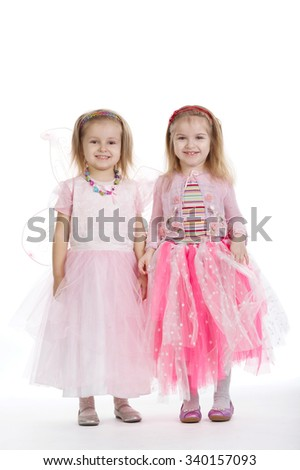 Two little girls - best friends on white background