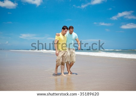 Two men walking on a beach