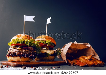 Woman chef holding cooked her delicious stock photo for Table burger
