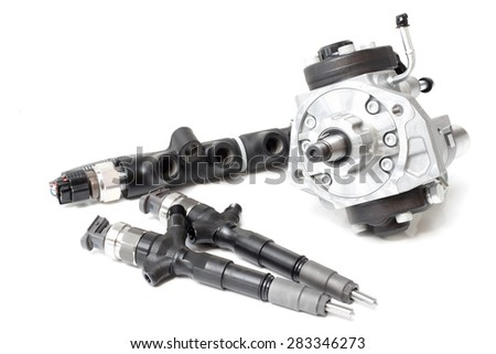 two new injectors for diesel fuel with the fuel pump are high davteniya and fuel strap on a white background