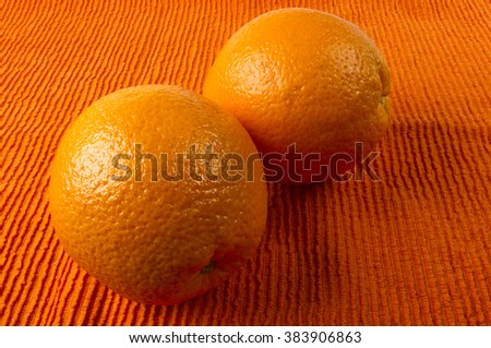 Two Orange on the textile orange background