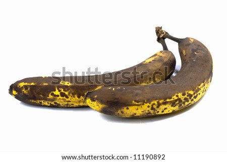 Two overripe bananas isolated on white