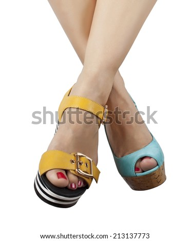 Two pairs of feet in different shoes and sandals