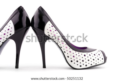 Two patent-leather shoes with a white background. Women's Accessories
