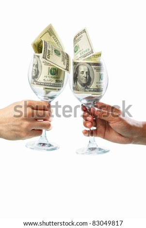 Two people toast using glass filled with dollar bills, isolated on white