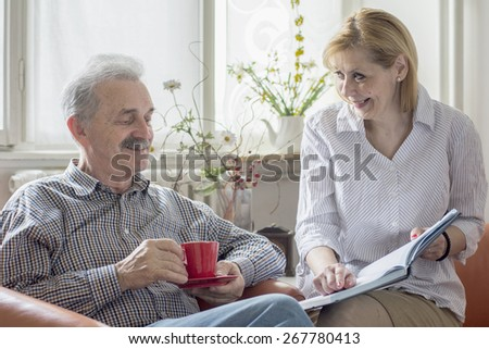 Two people with a book