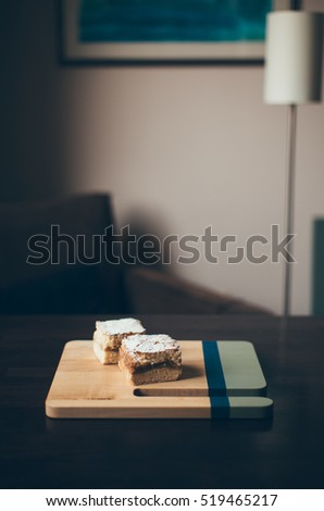 Two pieces of pie on wooden board