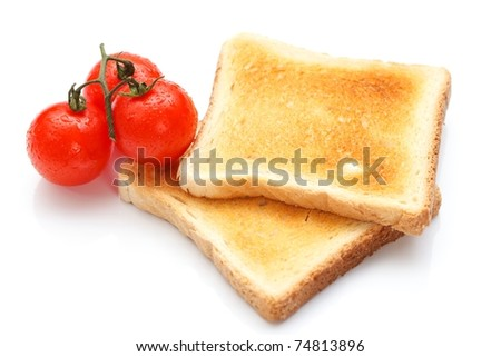 Two pieces of toast on the table with tomatoes