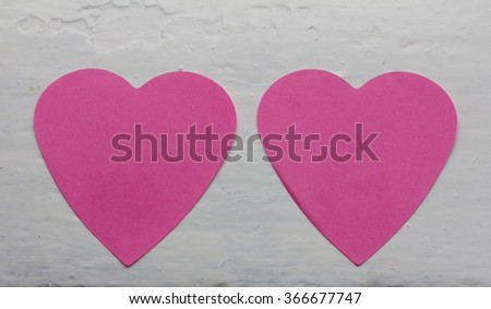 two pink paper heart on a background of white-painted surface. Copy space. Free space for text, Close-up, top view