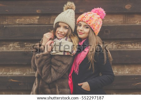 Two pretty girl are wearing warm winter clothes
