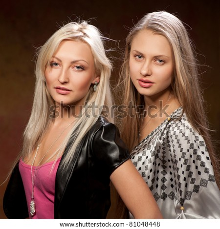 two pretty women on a colored background
