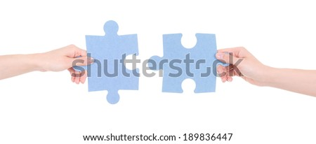 two puzzle pieces in woman hands isolated on white background