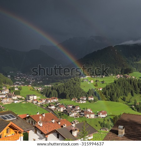 Two Rainbows above Val Gardena and St. Christina & Selva villages during a thunderstorm, Dolomites, Trentino, Alto-Adige, South Tyrol, Italy