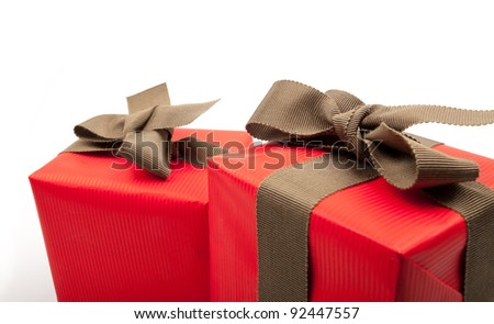 Two red gift boxes on white