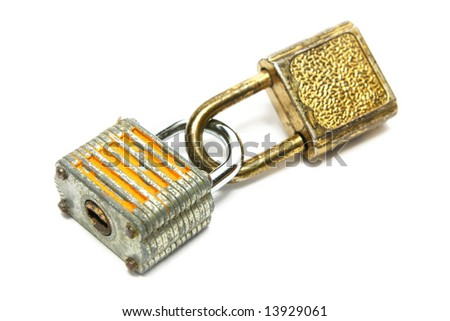 Two rusty locks locked each other on white background.
