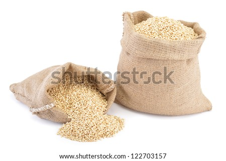 Two sacks of wheat grains isolated on white background